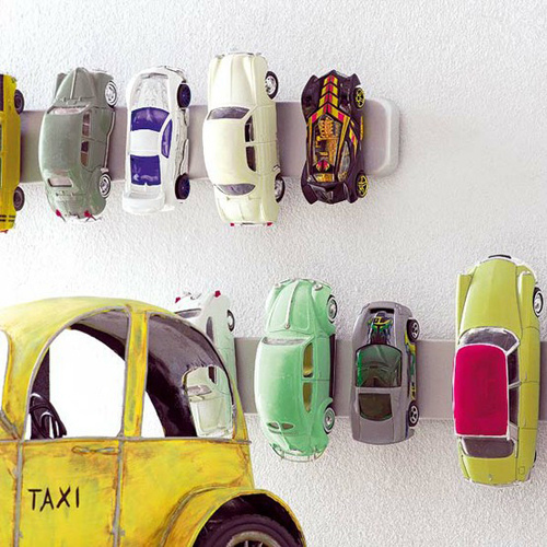 If you have a boy with lots of little metal toy cars than this is a perfect wall-mount storage solution for you. (via style-files)