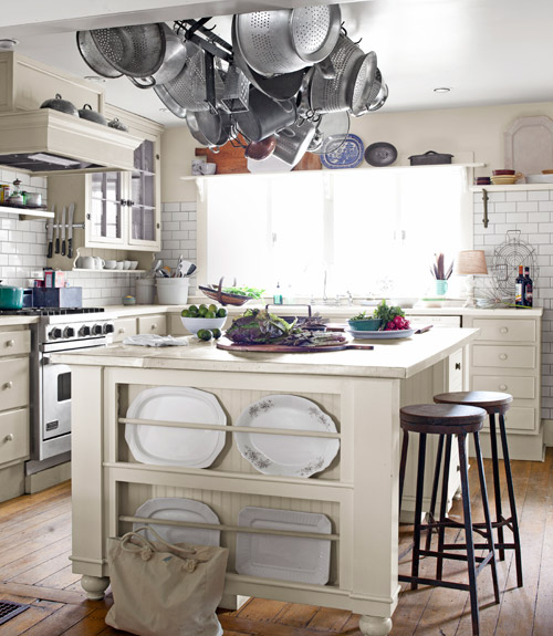 A plate rack set in a kitchen island (via countryliving)