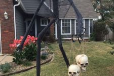 a PVC pipe yard Halloween monster with some skulls is an ultimate idea to scary everyone who comes on visit