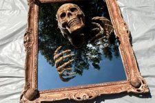 a chic skeleton mirror for Halloween decor