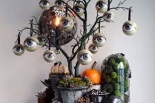 a creepy all-seeing tree is an ultimate idea for Halloween, add some skulls and spiders around