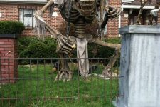 a giant skeleton prop like this one will make your outdoor space statement-like and extra bold, get inspired