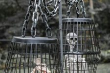 a metal stand with cages with a skeleton and a mouse skeleton is a very creepy and cool decoration for outdoors