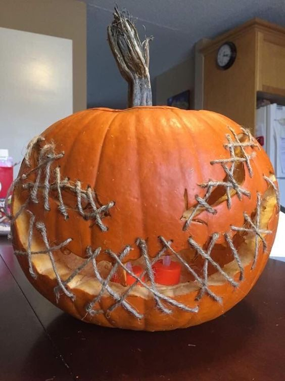 a pumpkin lantern with twine is a scary and easy decoration for Halloween