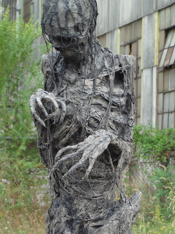 a scary mummy mad eof a skeleton and fabric in black is a gorgeous idea to go for in your front yard