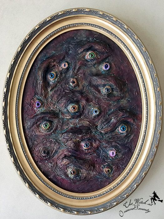a very creepy eye Halloween art in dark shades is a gorgeous decoration you can DIY for your party