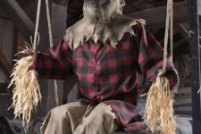 a very spooky outdoor Halloween decoration – a scarecrow dressed as a man is a cool and stylish idea