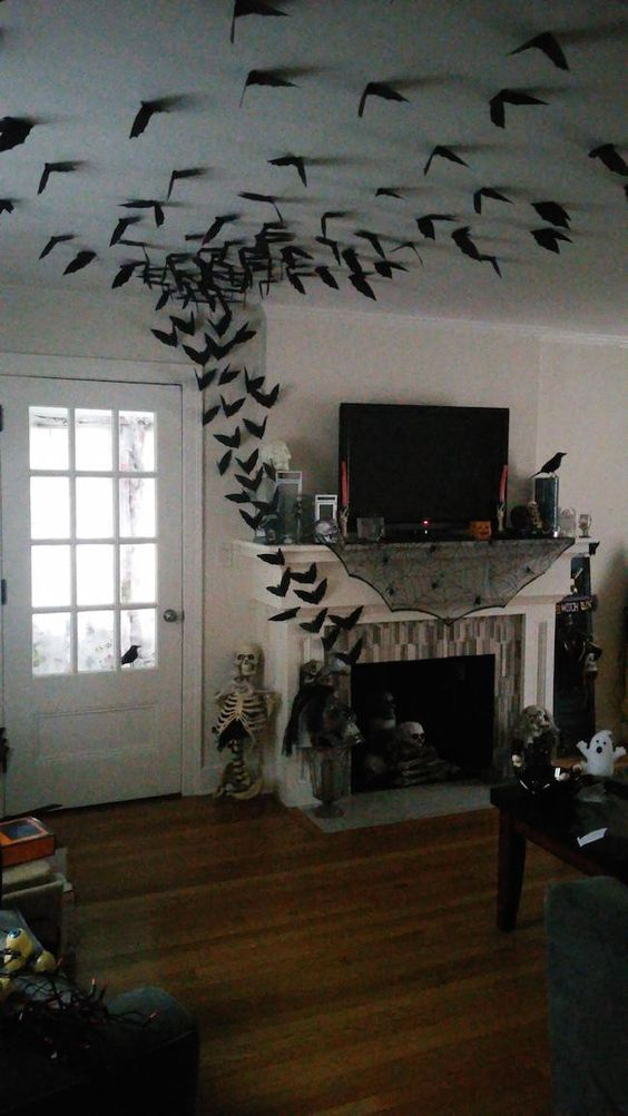 bats coming out of a fireplace and flying all over around are gorgeous scary Halloween decorations