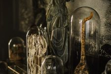 chic and spooky Halloween decor – various parts of bodies and monsters in cloches is a stylish refined idea
