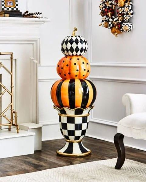 classic Halloween decor with porcelain black, white and orange pumpkins and a mini wreath in the same colors