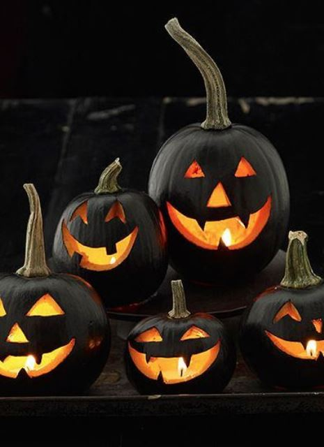 classic black Jack o lanterns with candles inside are a timeless decor idea for Halloween