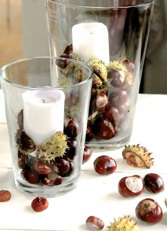 glasses with acorns and pillar candles are a cool decoration or centerpiece for the fall