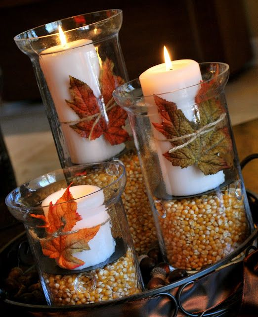 glasses with corn and pillar candles and dried leaves are a cool decoration for the fall