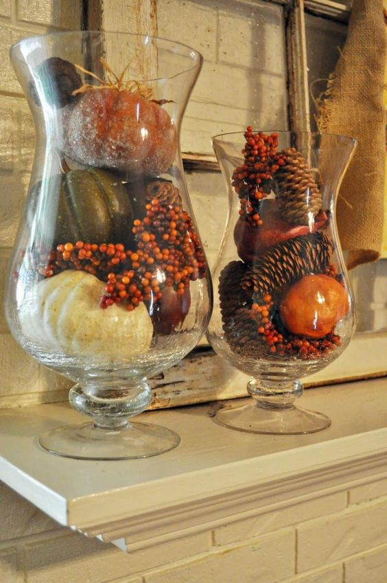 glasses with pinecones, faux berries, faux pumpkins and gourds for decorating a table or a mantel