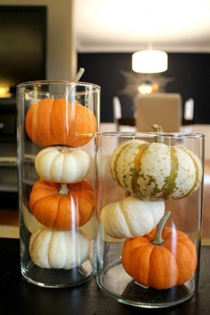 glasses with small pumpkins and gourds are simple and minimal fall decorations to make