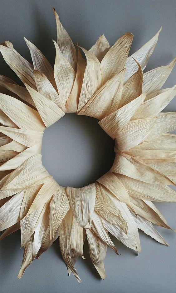 a corn husk wreath styled as a sunburst one is a cool all-natural decoration you will make easily