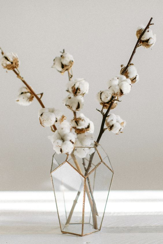 a geometric vase with cotton branches is a cool fall arrangement or centerpiece with a modern twist