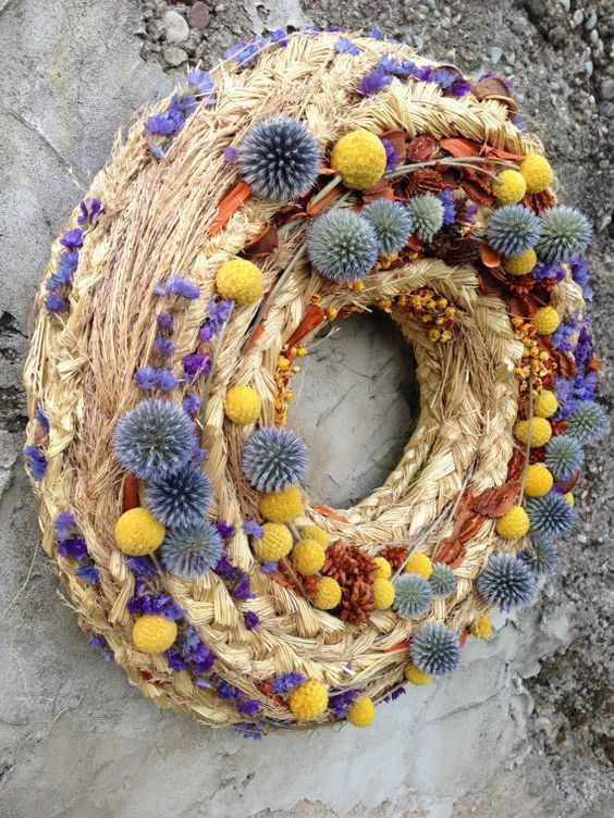 a woven fall wreath with allium, billy balls, lavender and dried blooms is a cool decoration to rock