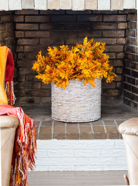 a wrapped vase with colorful fall leaves is a bold and cool fall decoration you cna easily make