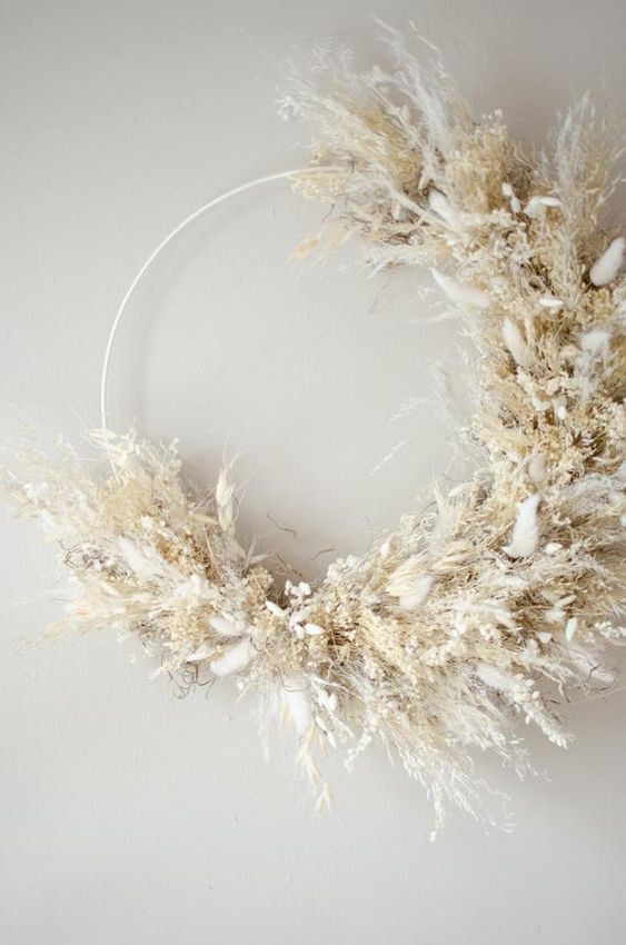 an ethereal and natural wreath made of pampas grass and dried flowers in neutrals is very beautiful