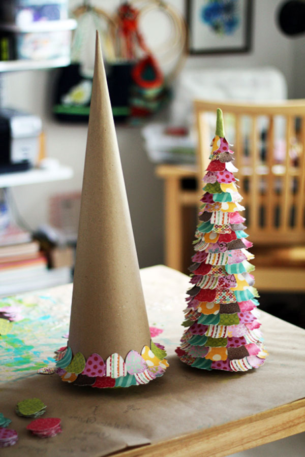 Recycled cardstock and old Christmas cards glued to the cardboard cone would become a perfect addition to your kid's room decor.