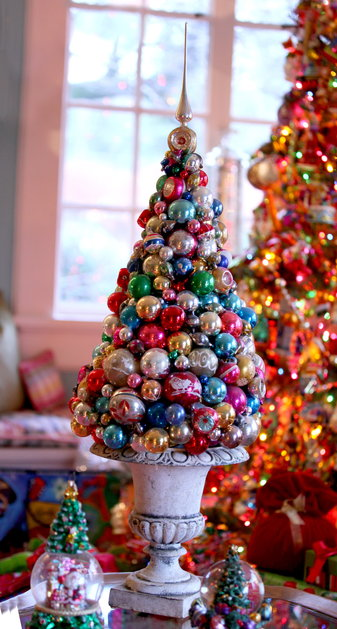 Styrofoam cone, glue and Christmas ornaments would become a perfect holiday tabletop topiary.
