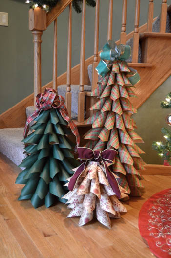 Using holiday wrapping paper or patterned scrapbooking paper you could make large cone-shaped festive trees fairly quick and easy.