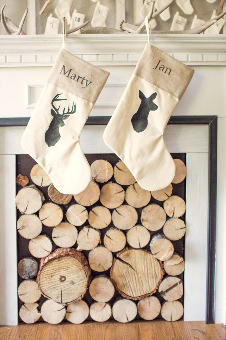 Do you have antlers lying on a mantel or a shelf? If so, they decorate your stockings with deer silhouettes and hang them on these antlers.