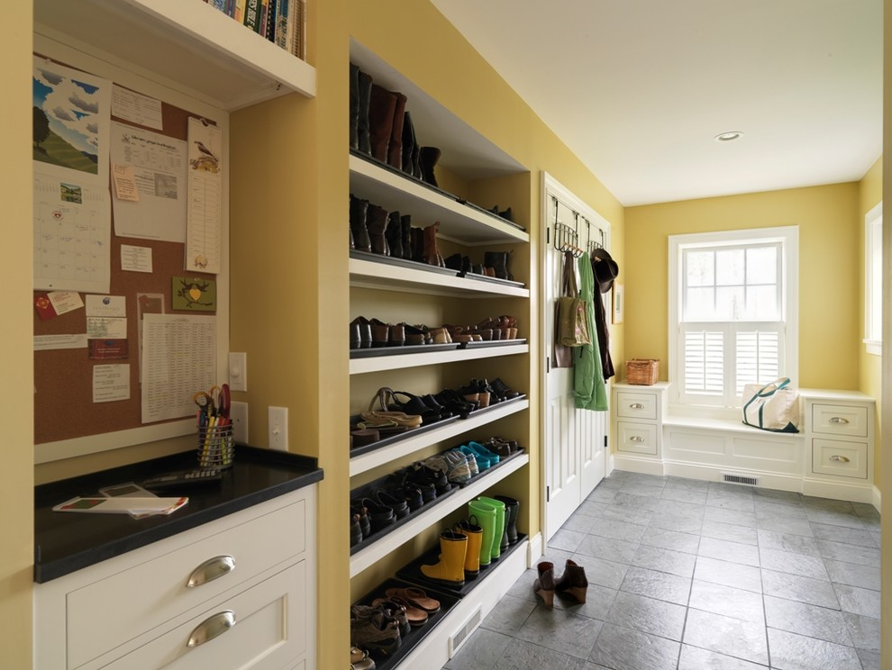 a great example of thoughtful mudroom shoe storage organization