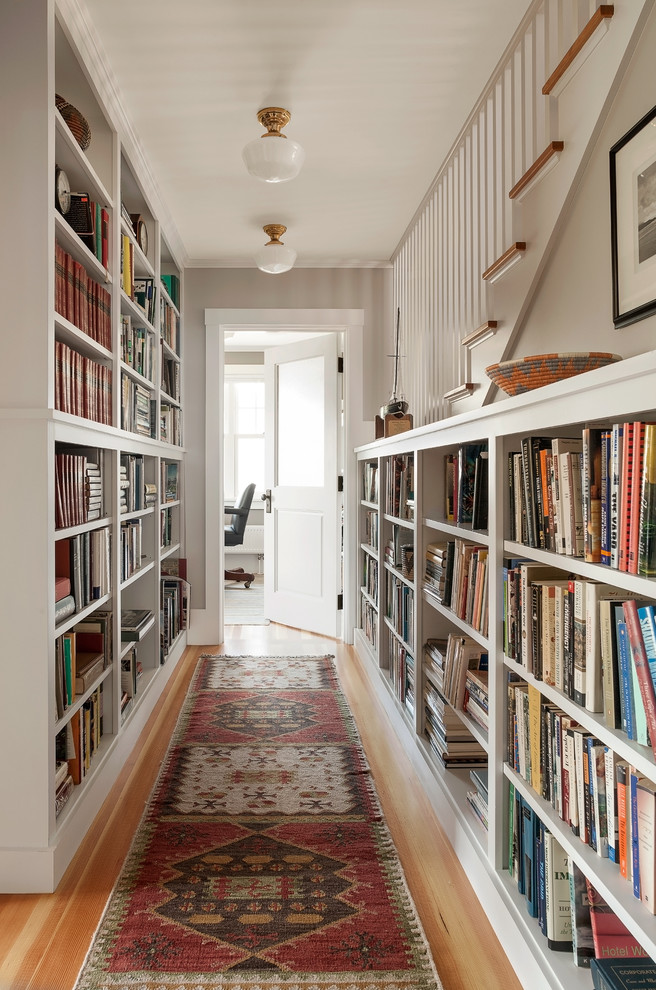 both walls in a long hallway could be used as a home library