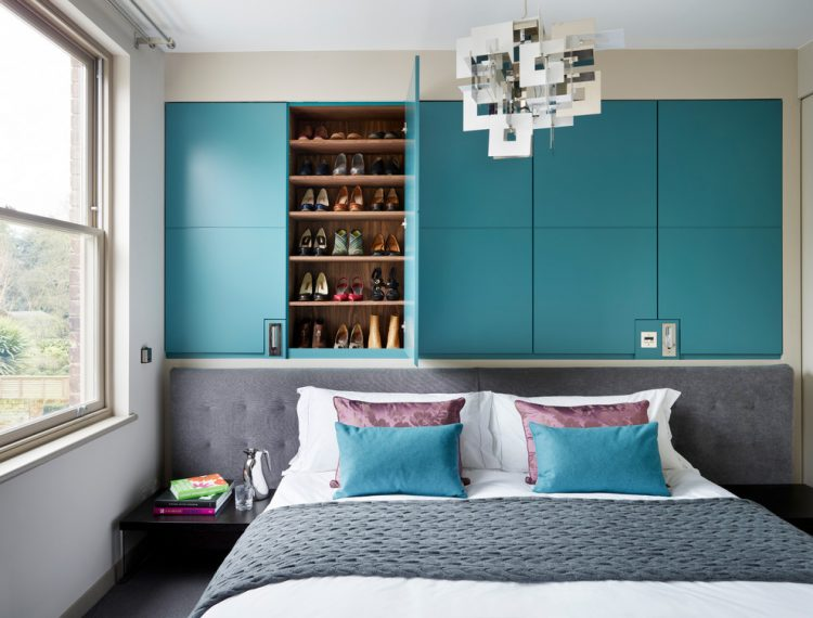 contemporary turquoise built in is in interestin space saving solution for a bedrrom that features storage for lots of things