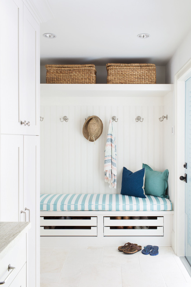 cute entryway with sliding under bench storage