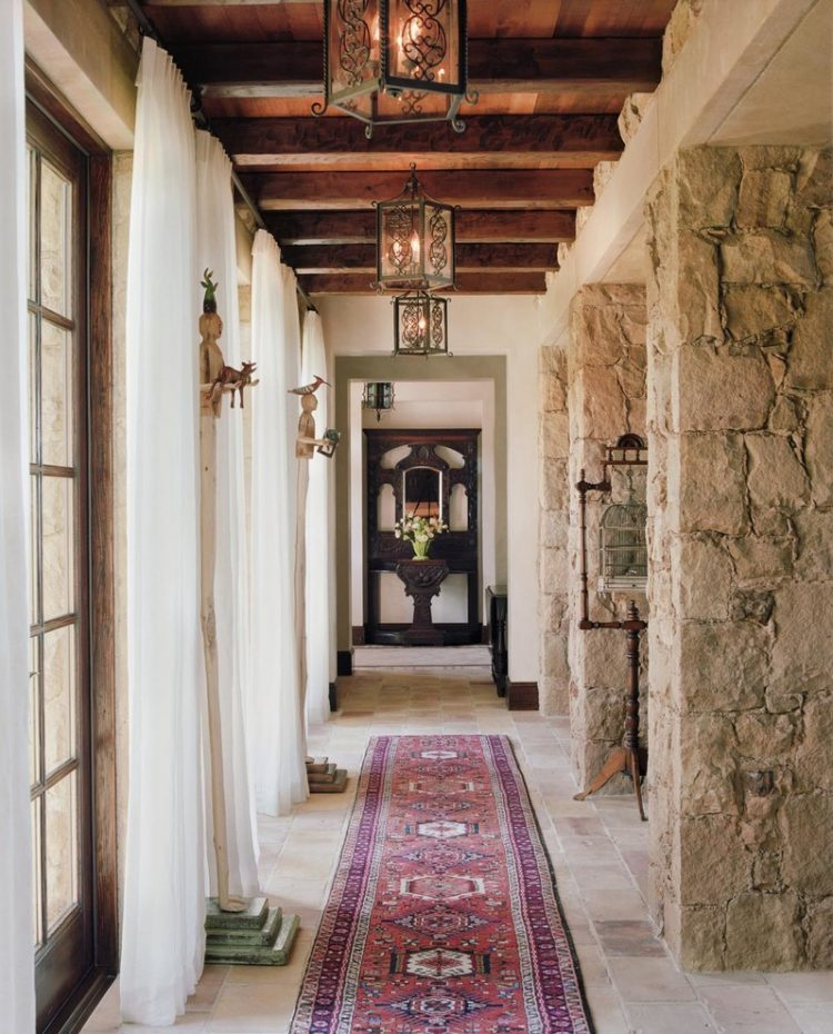 gorgeous farmhouse hallway with lots of natural wood and stone