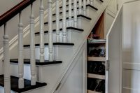 under-stairs is a perfect hidden shoe storage solution