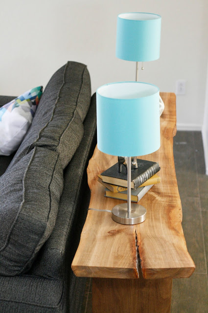 DIY floating console table made of a wood slab (via shelterness)