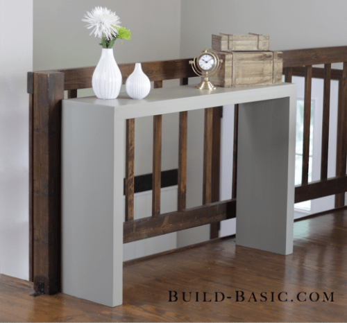 Simple DIY minimalist console table for any space (via shelterness)