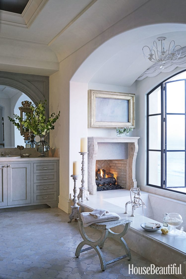 French Country Bathroom With A Wood Burning Fireplace