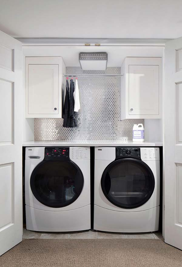 compact cloet laundry space deisgn with glossy hex tiles