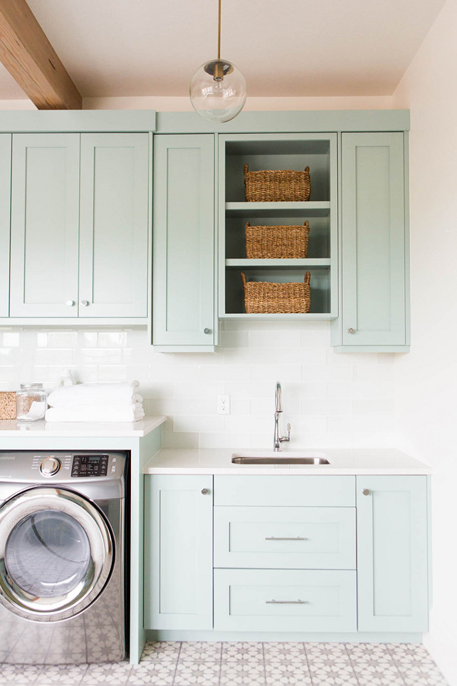 cute laundry room with beauitful cabinets and quartz countetops