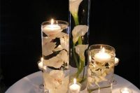 submerged flowers is an interesting alternative to traditional floral wedding centerpieces