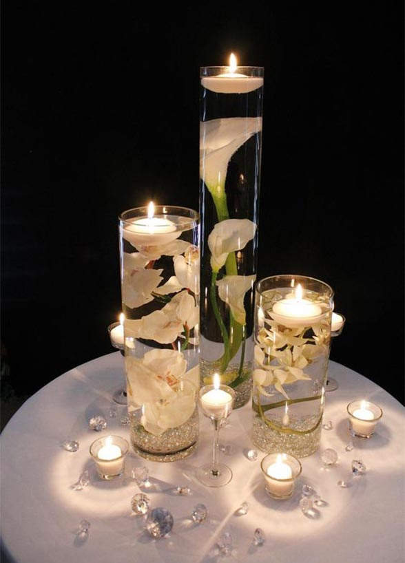37 floating flowers and candles centerpieces shelterness submerged flowers is an interesting alternative to traditional floral wedding centerpieces junglespirit Gallery