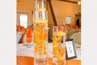 submerged orange orchids with candles are perfect for bright sunny days