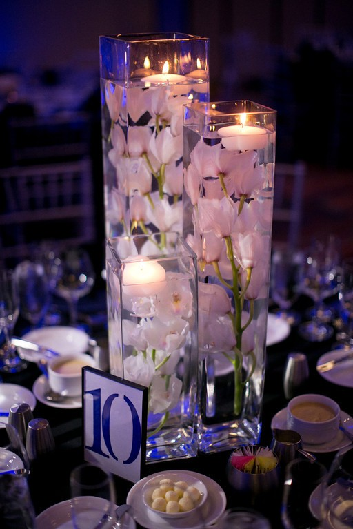 whole submerged flowers in a candle centerpiece