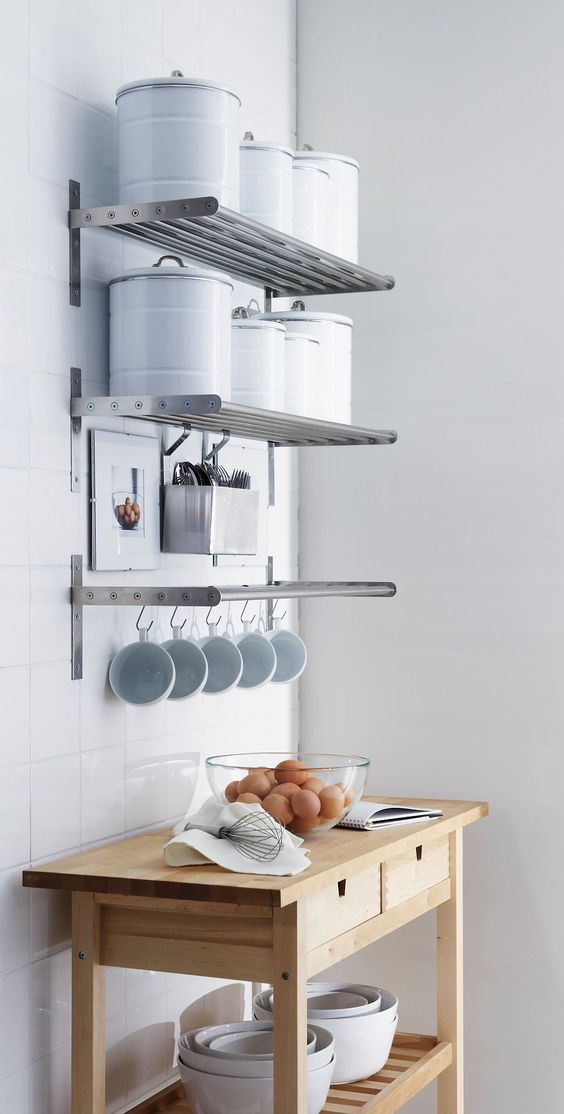 metal is a great and very practical material for kitchen shelves which could be used several ways