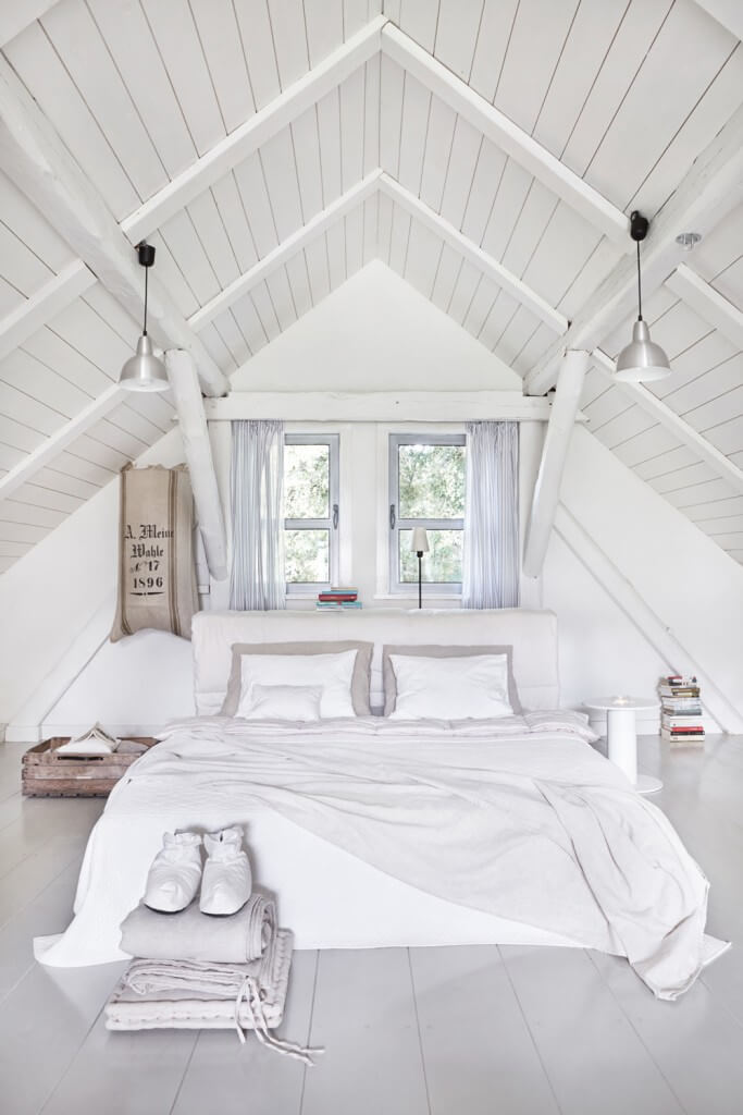 New all white bedroom beneath the vaulted ceiling