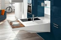 Cool furniture from Snaidero could be quite functional. It's a modern kitchen with a smart, compact design.