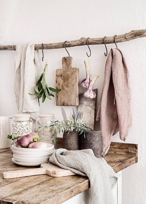 a branch with hooks over the countertop may be used for hanging literally anything you want and you have