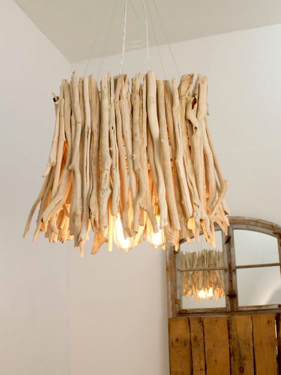 a chandelier made of bleached driftwood is a perfect option for a beach or a coastal house