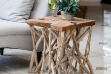 a cute side table made of branches as legs and a slice of wood for the tabletop is a very natural idea