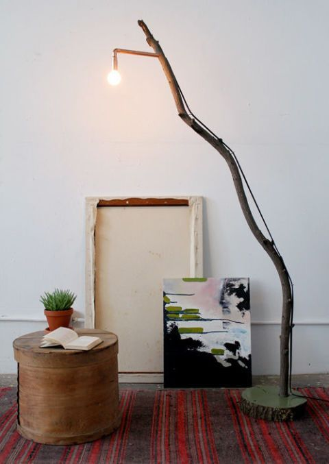 a floor lamp made of a concrete base, a large branch and a bulb is a stunning idea to DIY